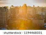 cityscape at sunset with a... | Shutterstock . vector #1194468331