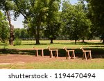 four sawhorses in a row stand... | Shutterstock . vector #1194470494