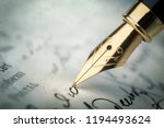 Fountain pen on an vintage handwritten letter. Old history background. Retro style. - stock photo