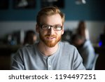 portrait of smiling red haired... | Shutterstock . vector #1194497251