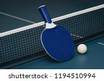 table tennis rackets and ball... | Shutterstock . vector #1194510994