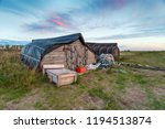 upturned boats used as... | Shutterstock . vector #1194513874