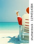 santa claus relaxing at chaise... | Shutterstock . vector #1194514384