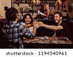 young multiracial friends... | Shutterstock . vector #1194540961