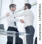 friendly handshake of business... | Shutterstock . vector #1194600361