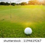 white golf ball on green course ... | Shutterstock . vector #1194619267