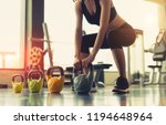 woman exercise workout at gym... | Shutterstock . vector #1194648964