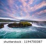godafoss waterfal  iceland.... | Shutterstock . vector #1194700387
