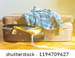 overloaded suitcase with... | Shutterstock . vector #1194709627