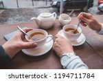 couple sitting in cafe drinking ... | Shutterstock . vector #1194711784