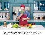 man cook vegetarian recipe with ... | Shutterstock . vector #1194779227