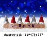 gnomes  blue background  bokeh  ... | Shutterstock . vector #1194796387