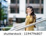 businesswoman walking down... | Shutterstock . vector #1194796807