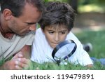 Father And Kid With Magnifying...