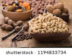cashew nuts peeled raw in bowl... | Shutterstock . vector #1194833734