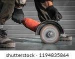 close up worker cutting metal... | Shutterstock . vector #1194835864