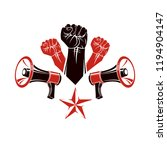 raised clenched fists vector... | Shutterstock .eps vector #1194904147