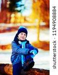 happy cute boy outdoor in the... | Shutterstock . vector #1194908884