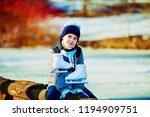 happy cute boy going ice... | Shutterstock . vector #1194909751