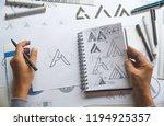 graphic designer drawing sketch ... | Shutterstock . vector #1194925357