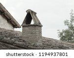 isolated chimney on the roof of ... | Shutterstock . vector #1194937801