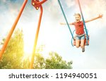 little girl swing on swing | Shutterstock . vector #1194940051