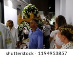 Small photo of Orthodox Christian worshiper take part in litany during a celebration of Dormition of the Mother of God in Naxos, Greece on Aug. 15, 2018