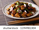 spicy sichuan eggplant is also... | Shutterstock . vector #1194981304