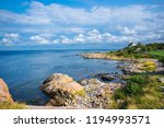 view of small town on beautiful ... | Shutterstock . vector #1194993571