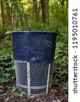 garbage can in middle of woods | Shutterstock . vector #1195010761