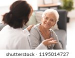 young doctor visiting elderly... | Shutterstock . vector #1195014727
