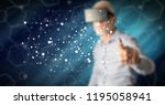 man with vr headset touching a...   Shutterstock . vector #1195058941