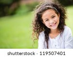sweet little girl outdoors with ... | Shutterstock . vector #119507401