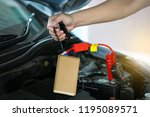 close up of hand charging car... | Shutterstock . vector #1195089571