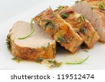 glazed pork fillet on a white... | Shutterstock . vector #119512474