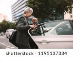 happy male getting into a cab.... | Shutterstock . vector #1195137334