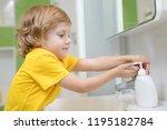 cute kid boy washing his hands... | Shutterstock . vector #1195182784