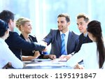 two business partners shaking... | Shutterstock . vector #1195191847