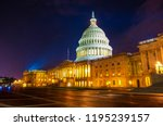 Stock photo time exposure of the east entrance to the white marble united states capital building at night with 1195239157