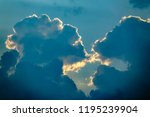 Small photo of Two clouds seem about to kiss before sunset in summer