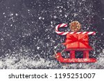red christmas sleigh carrying...   Shutterstock . vector #1195251007