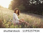 beautiful young woman sitting... | Shutterstock . vector #1195257934