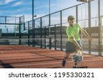 man playing padel in a orange... | Shutterstock . vector #1195330321