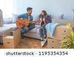 young couple moving to a new... | Shutterstock . vector #1195354354