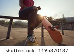 skateboarder use mobile phone... | Shutterstock . vector #1195370137