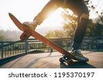 skateboarder skateboarding at... | Shutterstock . vector #1195370197