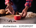barista's hands are delivering... | Shutterstock . vector #1195399297