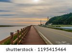 wooden walkway along a country... | Shutterstock . vector #1195415464