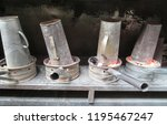 four metal coal braziers with... | Shutterstock . vector #1195467247