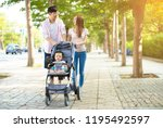 happy family with baby carriage ...   Shutterstock . vector #1195492597